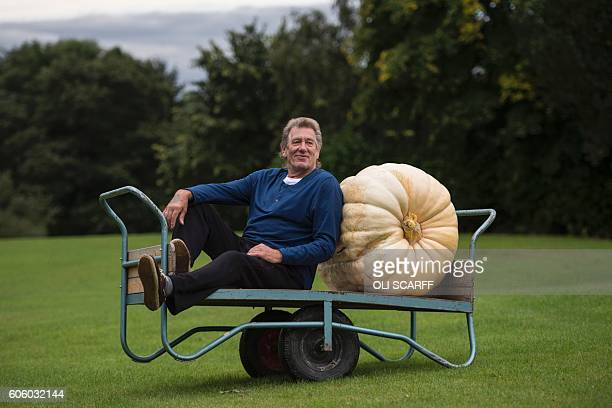 Brian Marshall poses for a picture with his 139.5kg pumpkin which won the Heaviest Pumpkin Competition at the Harrogate Autumn Flower Show at the...