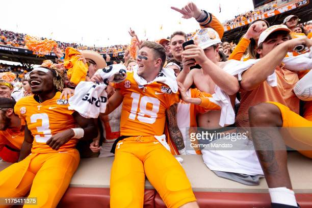 Brian Maurer and Eric Gray of the Tennessee Volunteers celebrate with fans after defeating the Mississippi State Bulldogs 20-10 at Neyland Stadium on...