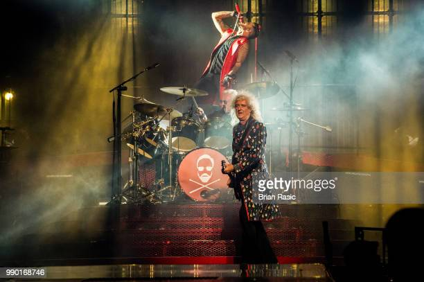 Brian May and Adam Lambert of Queen and Adam Lambert perform live on stage at The O2 Arena on July 2 2018 in London England