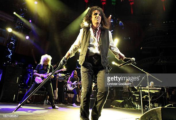 Brian May and Alice Cooper perform on stage during The Sunflower Jam at Royal Albert Hall on September 16, 2012 in London, United Kingdom.