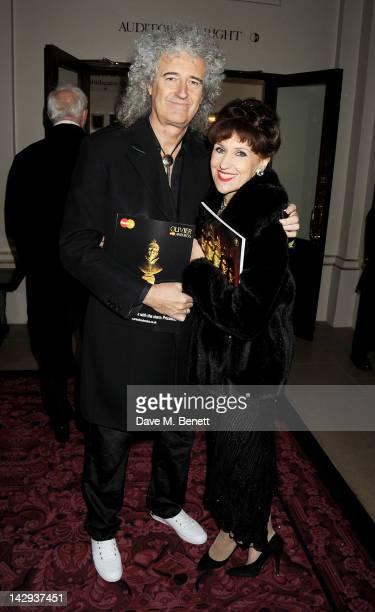 Brian May and Anita Dobson arrive at the 2012 Olivier Awards held at The Royal Opera House on April 15 2012 in London England