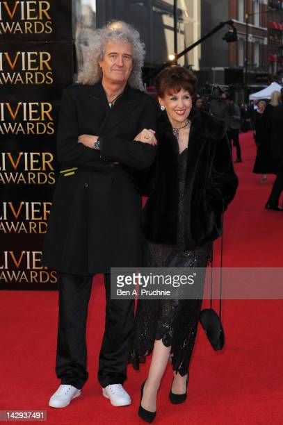 Brian May and Anita Dobson attend the 2012 Olivier Awards at The Royal Opera House on April 15 2012 in London England