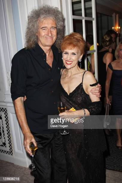 Brian May and Anita Dobson attend the Freddie For A Day 65th birthday anniversary at The Savoy Hotel on September 5 2011 in London United Kingdom