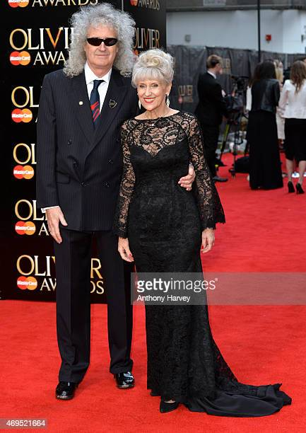 Brian May and Anita Dobson attend The Olivier Awards at The Royal Opera House on April 12 2015 in London England