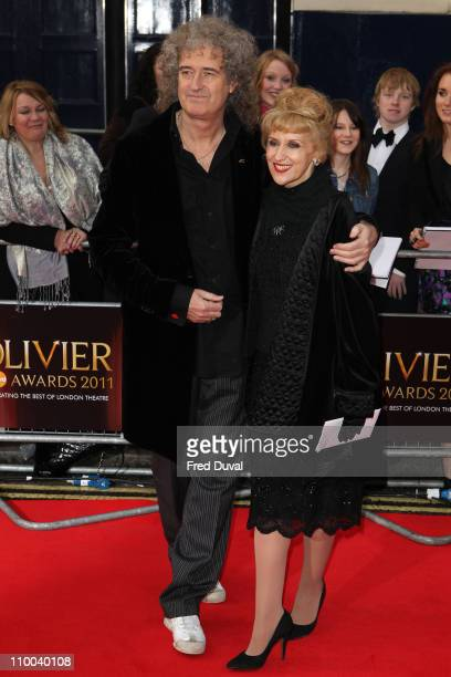 Brian May and Anita Dobson attend the Olivier Awards at Theatre Royal on March 13 2011 in London England