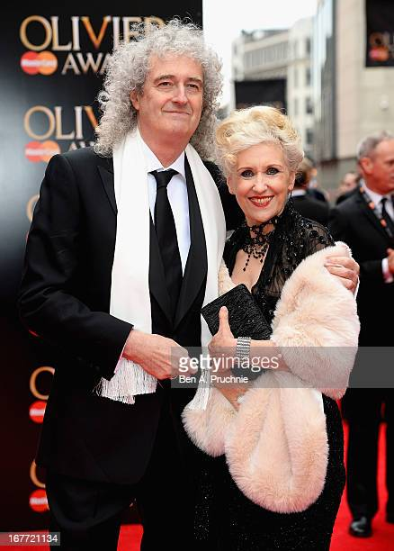 Brian May and Anita Dobson attends The Laurence Olivier Awards at the Royal Opera House on April 28 2013 in London England