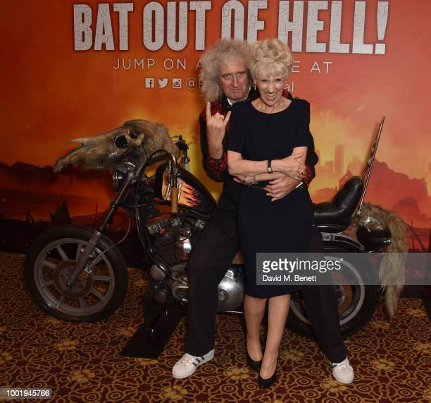 Brian May and Anita Dobson pose with cast members backstage at the West End production of 'Bat Out Of Hell The Musical' at The Dominion Theatre on...