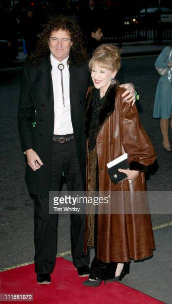 Brian May and Anita Dobson during 2006 Laurence Olivier Awards Outside Arrivals at London Hilton in London Great Britain