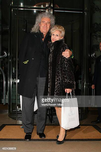 Brian May and Anita Dobson leaving The Langham Hotel on November 28 2013 in London England