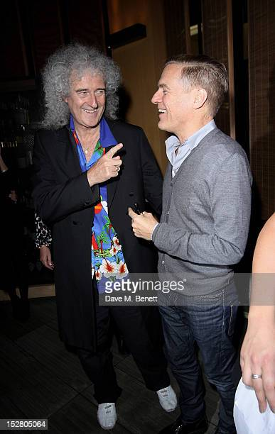 Brian May and Bryan Adams attend the Pig Business Fundraiser at Sake No Hana on September 26 2012 in London England