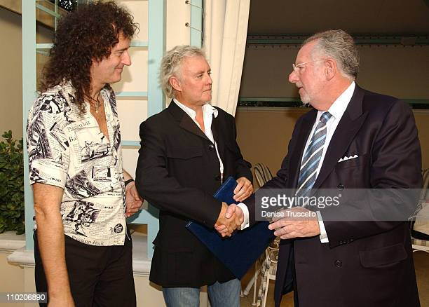 Brian May and Roger Taylor of Queen with Las Vegas Mayor Oscar Goodman