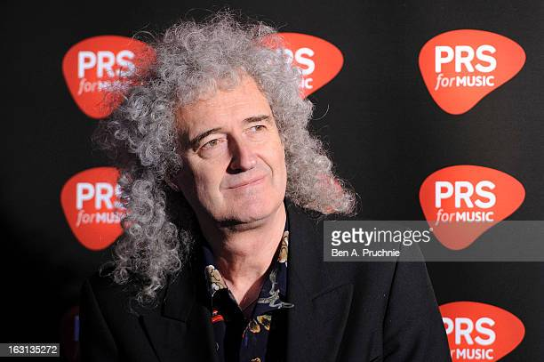 Brian May attends a photocall as Queen are awarded The Heritage award at Imperial College London on March 5 2013 in London England