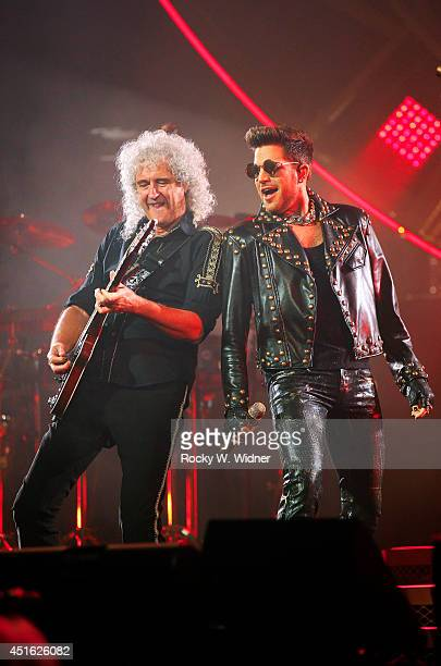 Brian May of Queen and Adam Lambert perform in concert at the SAP Center on July 1 2014 in San Jose California