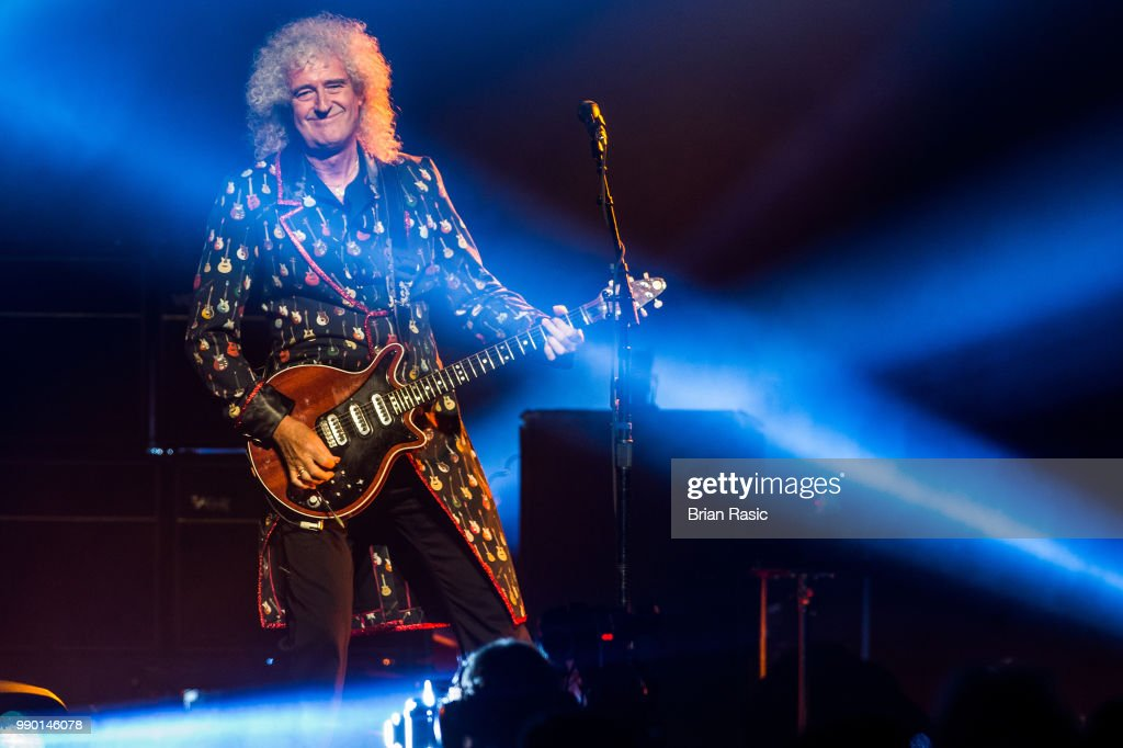 Brian May of Queen and Adam Lambert perform live on stage at The O2 Arena on July 2, 2018 in London, England.