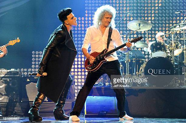 Brian May of Queen and Adam Lambert perform onstage during the MTV Europe Music Awards 2011 live show at at the Odyssey Arena on November 6, 2011 in...