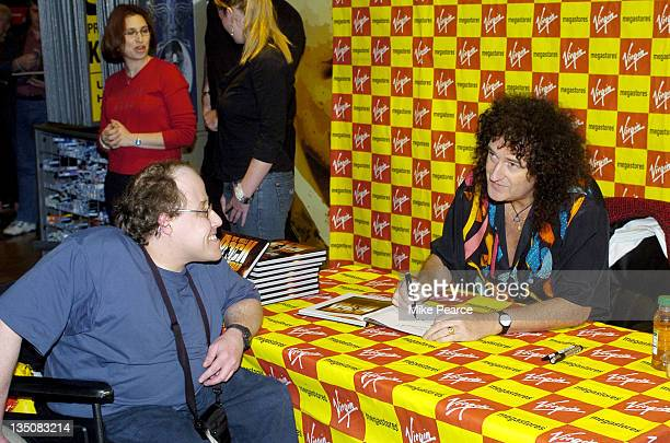 """Brian May of Queen during Brian May Signs """"We Will Rock You"""" Show Book at Virgin Megastore Piccadilly in London, Great Britain."""
