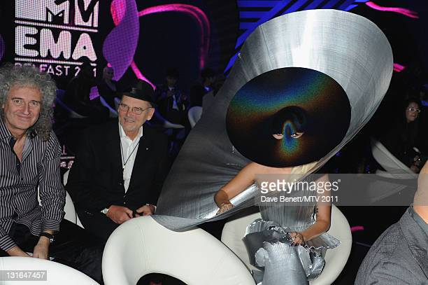 Brian May of Queen Manager of Queen Jim Beach and Lady Gaga poses in the VIP Glamour area during the MTV Europe Music Awards 2011 at Odyssey Arena on...