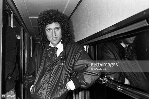Brian May of Queen on board a train from Leiden to Amsterdam Netherlands after a gig at Groenoordhal Leiden 25th April 1982