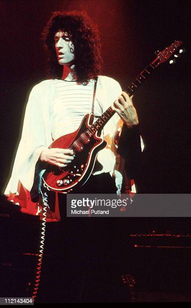 Brian May of Queen performs on stage Rainbow Theatre London November 1974