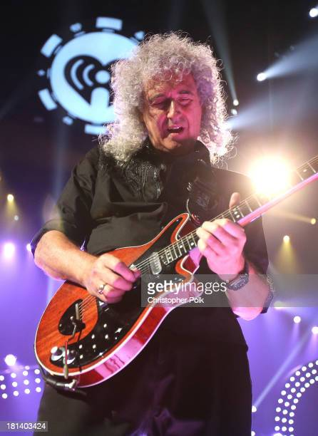 Brian May of Queen performs onstage during the iHeartRadio Music Festival at the MGM Grand Garden Arena on September 20 2013 in Las Vegas Nevada