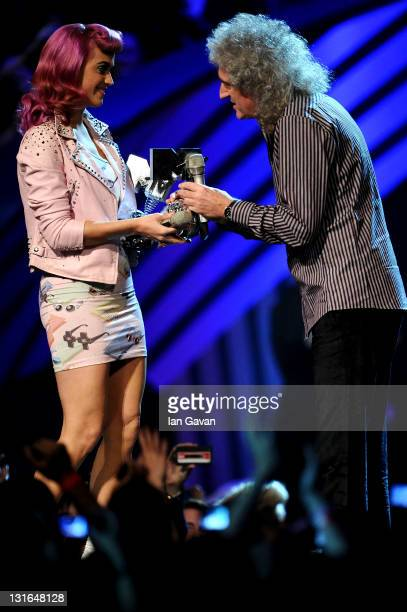 Brian May of Queen receives the award for Global Icon from singer Katy Perry during the MTV Europe Music Awards 2011 live show at at the Odyssey...