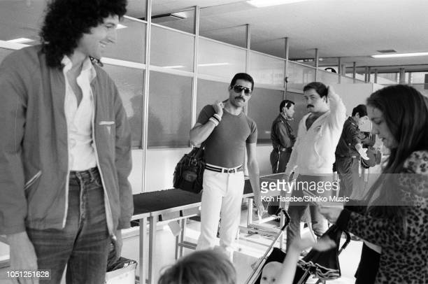 Brian May of Queen with his wife Christine Mullen and family and Freddie Mercury at Fukuoka Airport on the Hot Space Japan tour Fukuoka Japan 19...