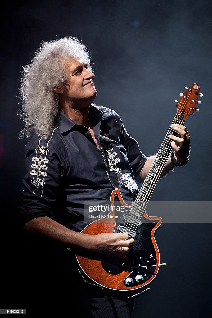 Brian May on stage during the curtain call of the final performance of 'We Will Rock You' at the Dominion Theatre on May 31, 2014 in London, England.
