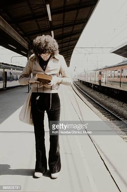 Brian May on the platform Kyoto April 1975