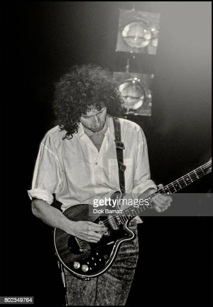 Brian May performing on stage with Jerry Lee Lewis at the Hammersmith Apollo London 1989