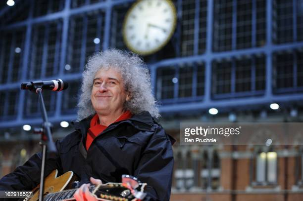 Brian May performs at the Tiger Tracks event to raise funds for the Save Wild Tigers initiative at St Pancras Station on March 1 2013 in London...