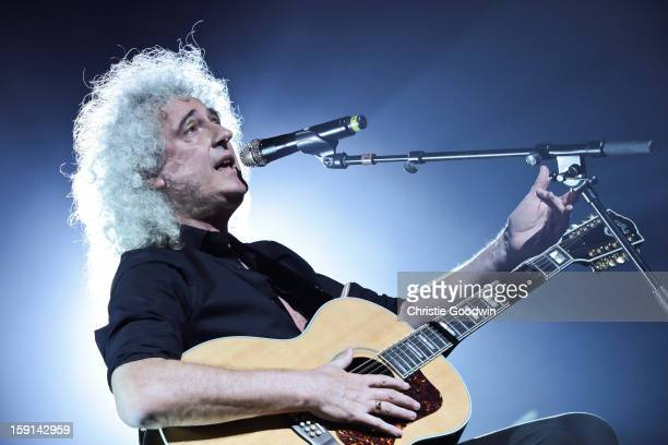 Brian May performs on stage as Queen Adam Lambert at HMV Hammersmith Apollo on July 12 2012 in London United Kingdom
