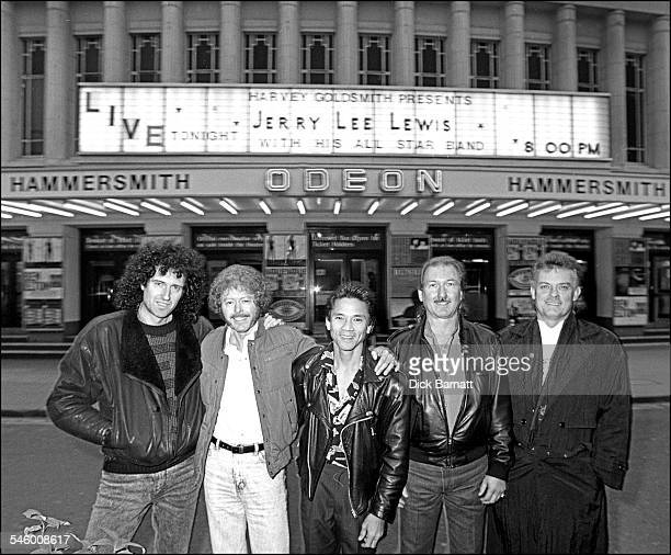 Brian May poses with Jerry Lee Lewis' All Star band outside Hammersmith Odeon Londom 1988 LR Queen guitarist Brian May guitarist Kenny Lovelace...