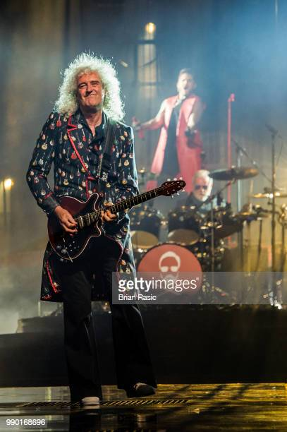 Brian May Roger Taylor and Adam Lambert of Queen and Adam Lambert perform live on stage at The O2 Arena on July 2 2018 in London England