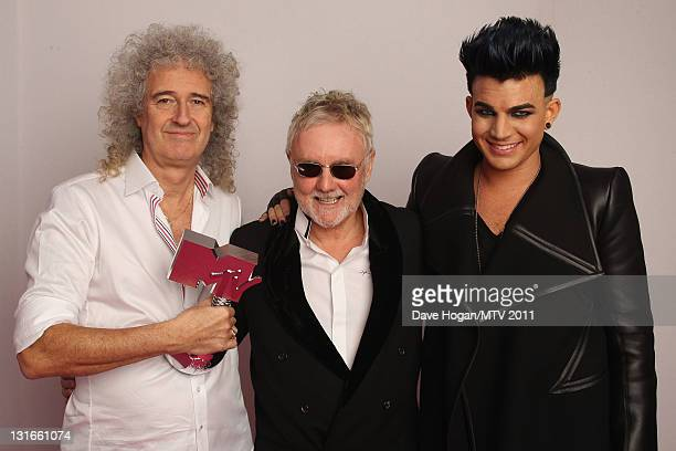 Brian May Roger Taylor and Adam Lambert pose backstage with the Global Icon award during the MTV Europe Music Awards 2011 at Odyssey Arena on...