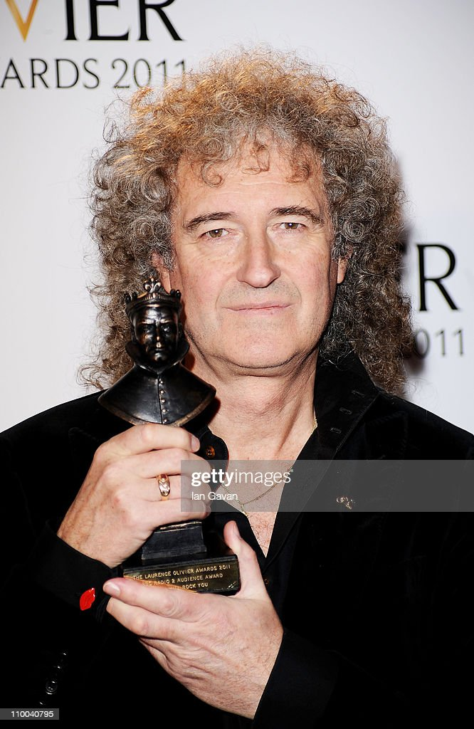 Brian May, winner of BBC Radio 2 Audience Award for Most Popular Show for 'We Will Rock You' poses in the press room during The Olivier Awards 2011 at Theatre Royal on March 13, 2011 in London, England.