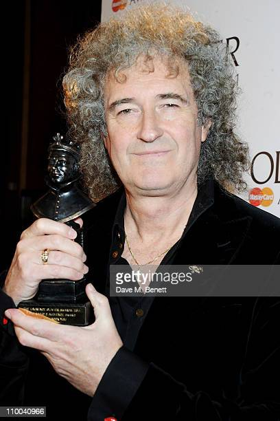 Brian May with the BBC Radio 2 Audience Award for Most Popular Show poses in the winner's room during the Olivier Awards 2011 at Theatre Royal Drury...