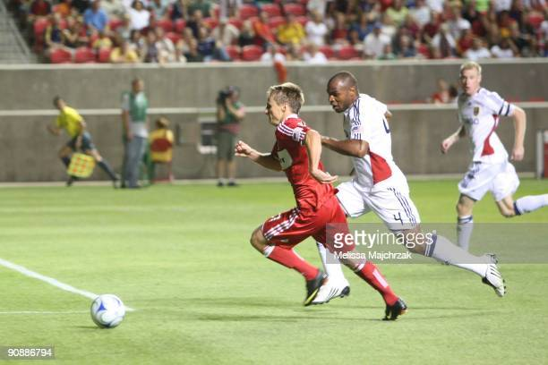 Brian McBride of Chicago Fire goes after the ball against Jamison Olave of Real Salt Lake at Rio Tinto Stadium on September 12 2009 in Sandy Utah