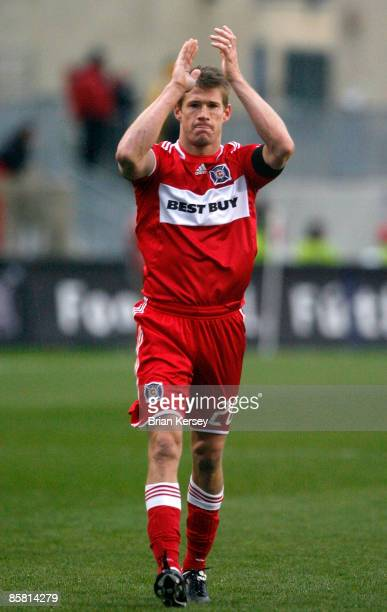 Brian McBride of the Chicago Fire applauds the fans after the Fire's win over the New York Red Bulls at Toyota Park on April 5, 2009 in Bridgeview,...
