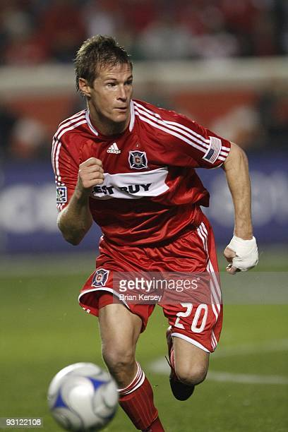 Brian McBride of the Chicago Fire chases after the ball against Real Salt Lake during the second half of the MLS Eastern Conference Championship at...