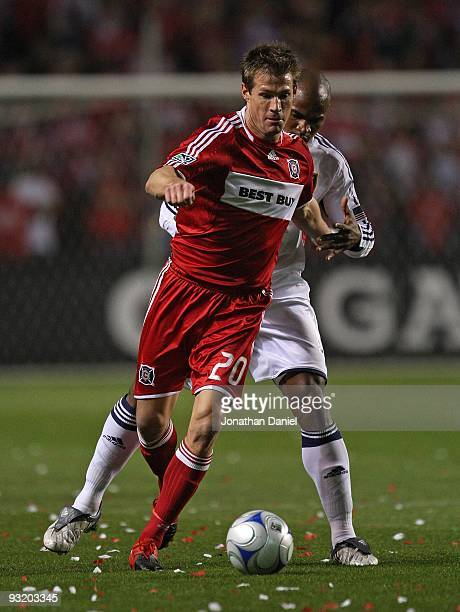 Brian McBride of the Chicago Fire controls the ball against Jamison Olave of Real Salt Lake during the MLS Eastern Conference Championship at Toyota...