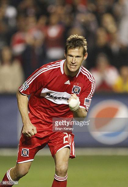 Brian McBride of the Chicago Fire pumps his fist after scoring during the shootout against Real Salt Lake during the MLS Eastern Conference...