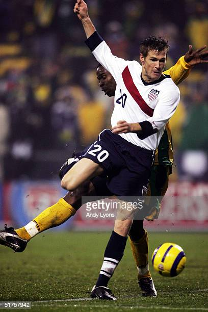 Brian McBride of the United States fights for the ball against Jamaica during the World Cup qualifier match at Crew Stadium on November 17, 2004 in...