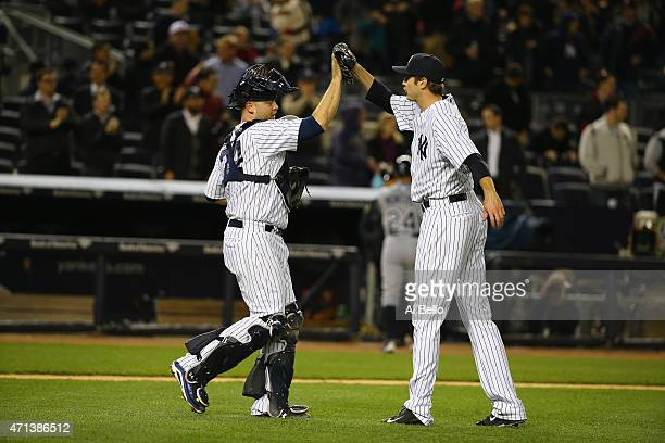 Brian McCann and Andrew Miller of the New York Yankees celebrate a 41 win against the Tampa Bay Rays during their game at Yankee Stadium on April 27...