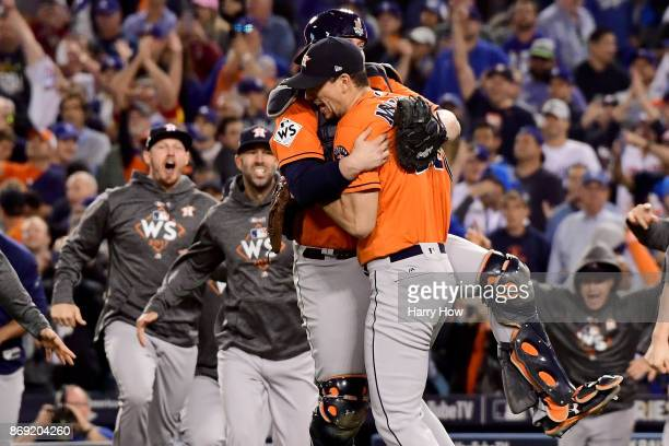 Brian McCann and Charlie Morton of the Houston Astros celebrate with teammates after defeating the Los Angeles Dodgers in game seven with a score of...