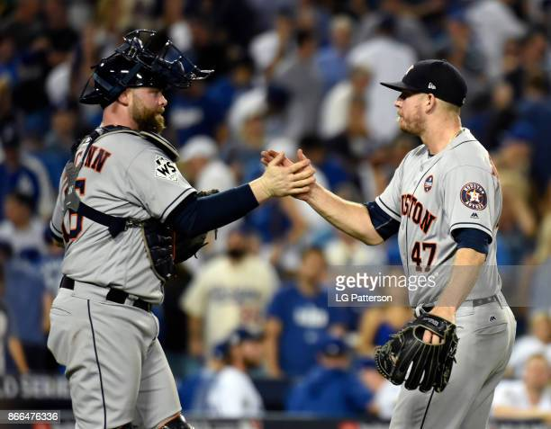 Brian McCann and Chris Devenski of the Houston Astros celebrate after winning Game 2 of the 2017 World Series against the Los Angeles Dodgers at...