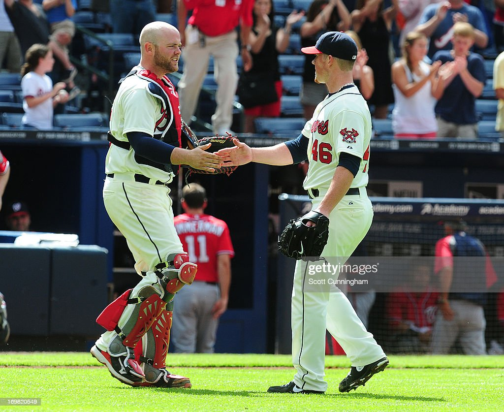 Brian McCann #16 and Craig Kimbrel #46 of the Atlanta Braves celebrate after the game against the Washington Nationals at Turner Field on June 2, 2013 in Atlanta, Georgia.