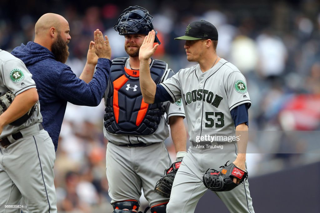 Brian McCann #16 and Ken Giles #53 of the Houston Astros celebrate after defeating the New York Yankees 5-1 at Yankee Stadium on Monday, May 28, 2018 in the Bronx borough of New York City.