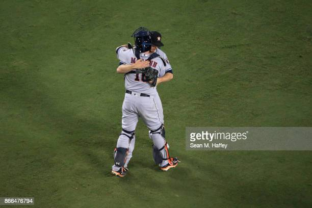 Brian McCann celebrates with Chris Devenski of the Houston Astros after defeating the Los Angeles Dodgers 76 in eleven innings to win game two of the...