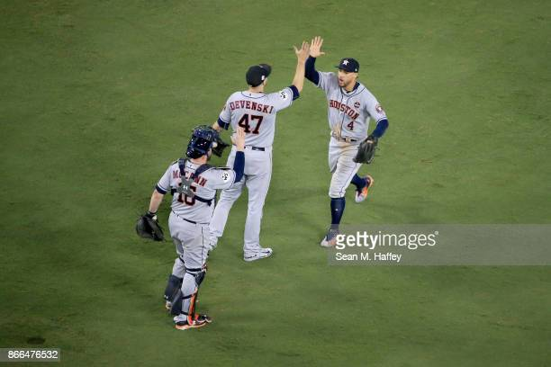 Brian McCann Chris Devenski and George Springer of the Houston Astros celebrate defeating the Los Angeles Dodgers 76 in eleven innings to win game...
