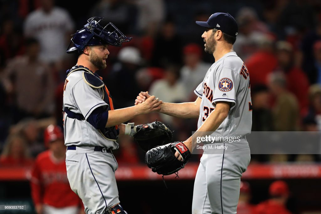 Brian McCann #16 congratulates Justin Verlander #35 of the Houston Astros after defeating the Los Angeles Angels of Anaheim 2-0 in a game at Angel Stadium on May 16, 2018 in Anaheim, California.